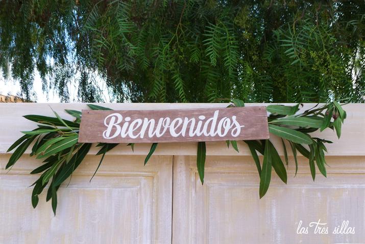 cartel_bienvenidos_puerta_paso